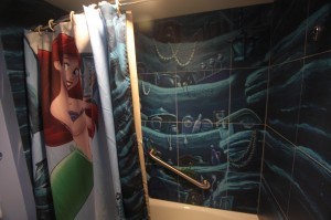 "The shower is Ariel's grotto. I wonder if the designers realized this is a symbol of a womb in the movie, from which our adolescent must be ""born"" into adulthood?"
