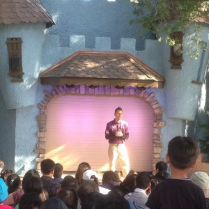 Puppeteer, Justin delights crowds in front of the newly renovated Puppet Theater.
