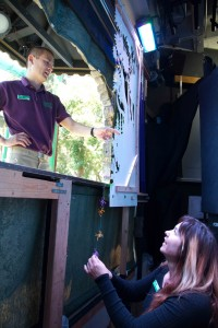 Justin and Kimy pointing out new additions to the Puppet Theater.