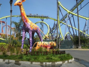The park entrance showcases both coasters and wildlife.