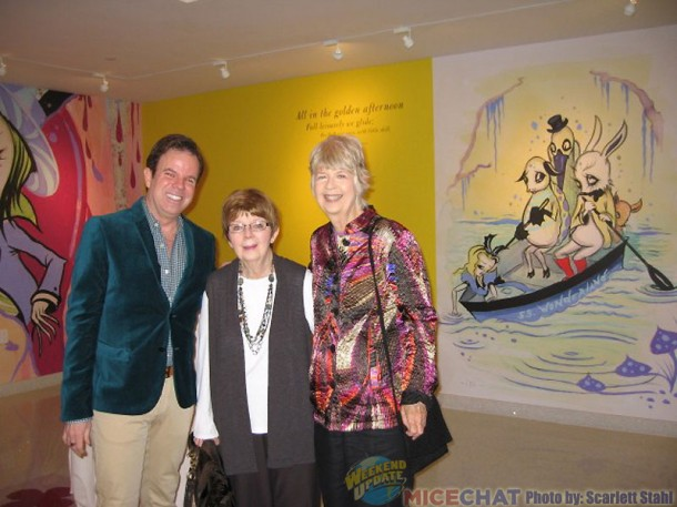 Kevin and Jeanne Chamberlain, and Maggie Richardson with the ARt of CAmille Rose Garcia covering the wall.