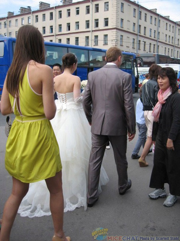 Wedding party and their bus