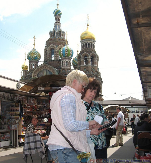 Bargaining at a little market near The Church of Our Saviour of the Spilled Blood