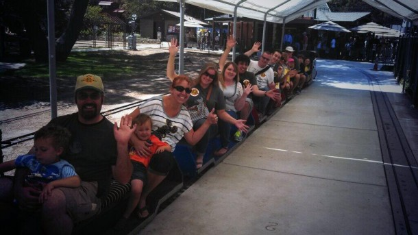 A group of The Optimists ride the trains near Walt's Barn