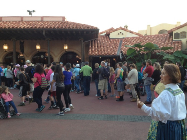 In the background: a 60-minute line for Pirates. In the foreground: one of a few CM's hawking Tortuga Tavern Buffet menus (there were about five families inside eating)