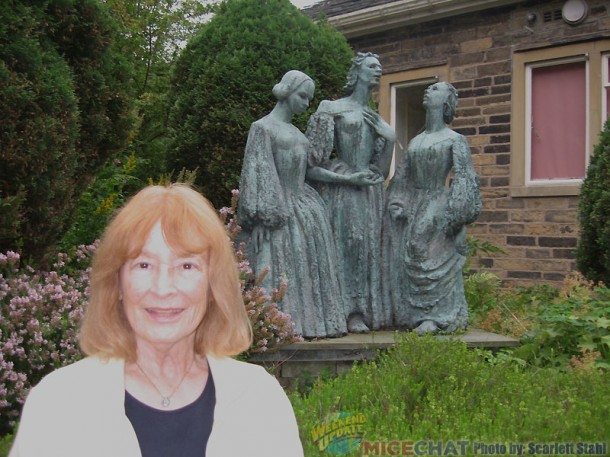 Scarlett in the garden with the statue of the three Bronte sisters