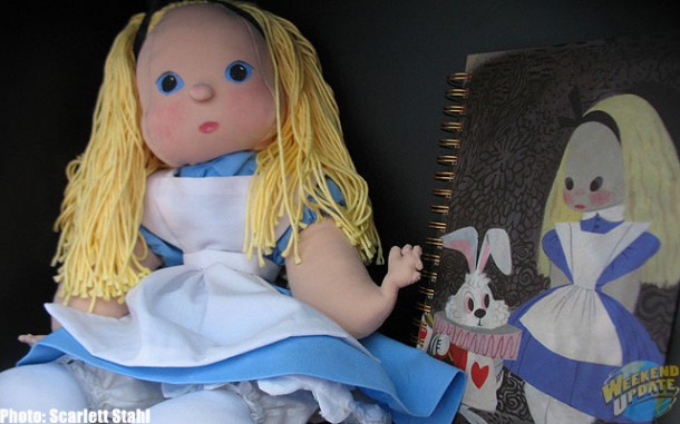 Alice doll and notebook in Maggie's bookcase