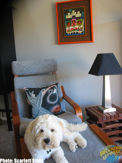 "The Mary Blair reading corner in Maggie's living room with Disney Cinderella pillow in chair and original ""Children's Chorus"" on wall --- A favorite relaxing spot for Maggie's dog Doodle."