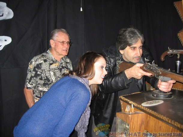 Mark Silverman playing the arcade game, being observed by Jessica Haganey and Bill Hogarth, formerly of Disneyland Arcades)