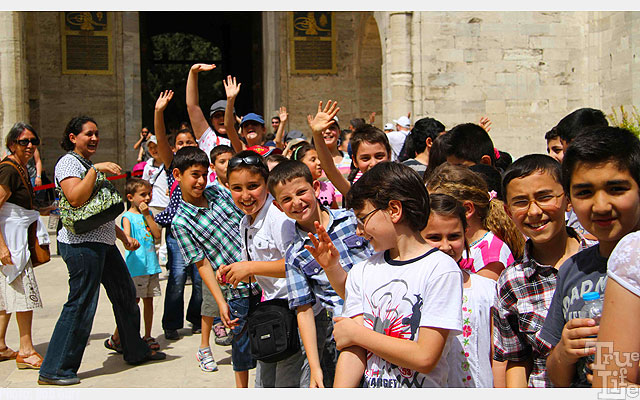 Friendly school children greet visitors to Turkey warmly
