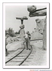 """The Rainbow Caverns Mine Train was one of Walt Disney's favorite attractions in Frontierland. Here he surveys his version of the Painted Desert in 1957."""