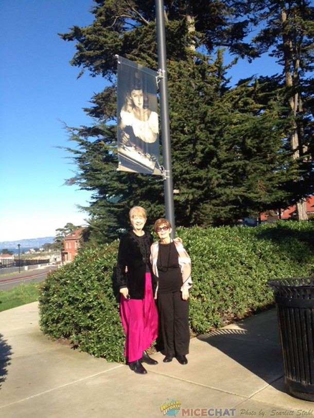Maggie and Jeanne at the Mary Blair banner