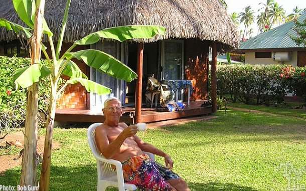 Bob enjoying high tea at his thatched hut