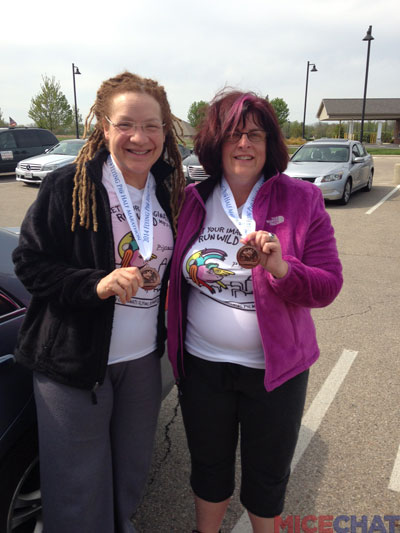 "Terri and Anita with their ""Flying Pig Race Finisher Medals."""