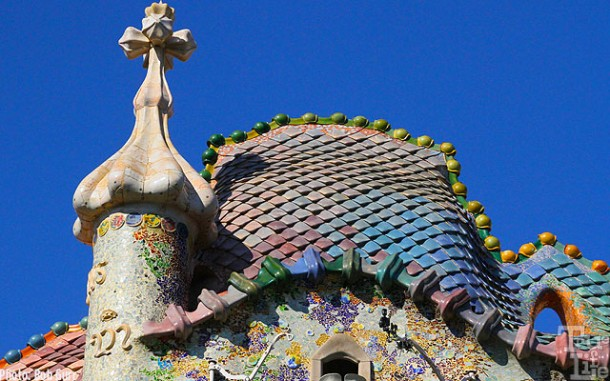 The fantastical tile covered chimney and roof of Gaudi's Batilo