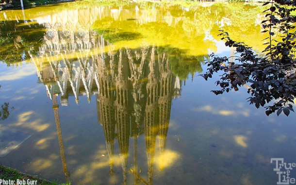 Barcelona's premier cathedral La Sagrada Familia in pond reflection