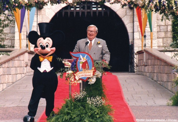 Jack Lindquist speaking at a Disneyland Ambassador event in front of Sleeping Beauty Castle