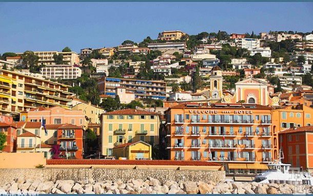 The hillside is home to many colorful riviera style villas