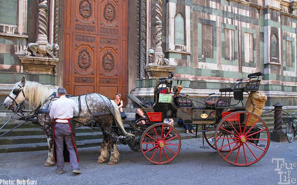 While there are cars in historic Florence, a carriage seem more fitting