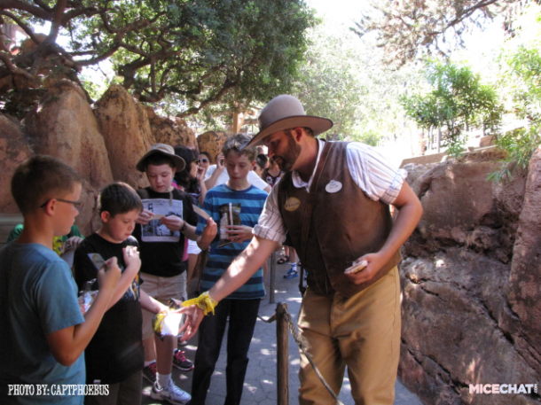 Willum works the Big Thunder line to hand out name badges, and encourage people to play after they get off the ride.
