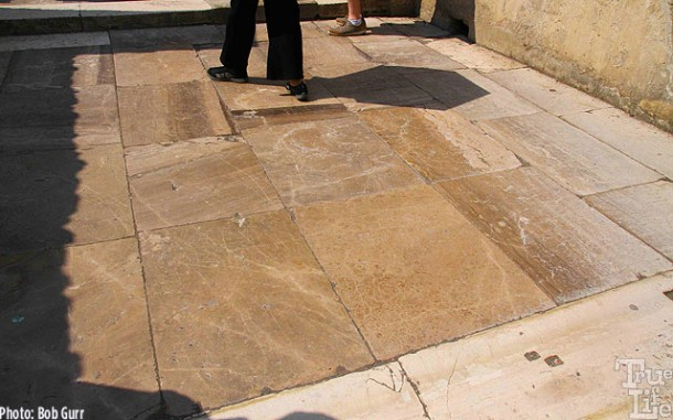 A large bath house entry is paved in polished marble.
