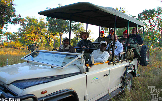 Two rangers explain every detail of the wildlife to safari guests