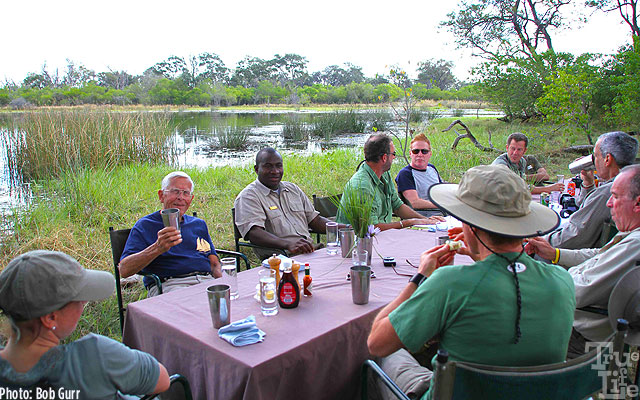 True-Life Adventure Bob enjoys a gin and tonic at a hippo filled pond