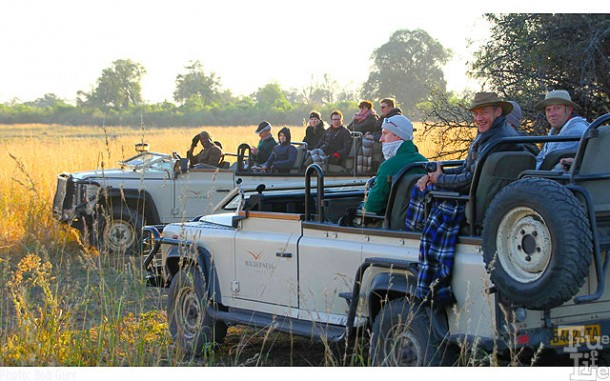 These folks are watching a leopard just a few yards distant that ignores them
