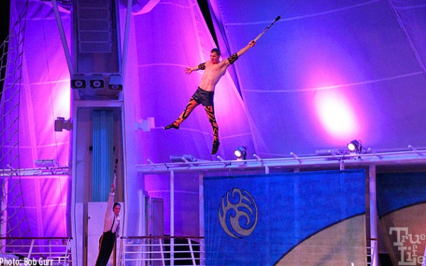 Aerialists perform with high wire acts on a moving ship at sea - amazing!
