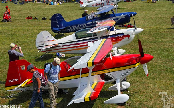 A line of colorful home built sport aviation airplanes