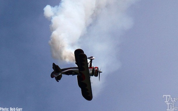 This big Waco biplane is happy to fall upside down and…
