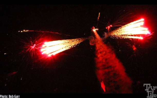 A helicopter air launches fireworks during the spectacular night airship