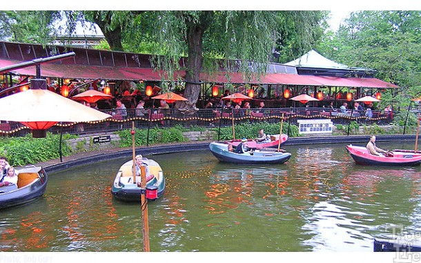One can dine in a cute pavilion while watching silent little electric boats