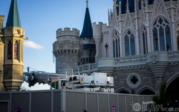 There is a crane on site for removal of the holiday lights from Cinderella Castle.