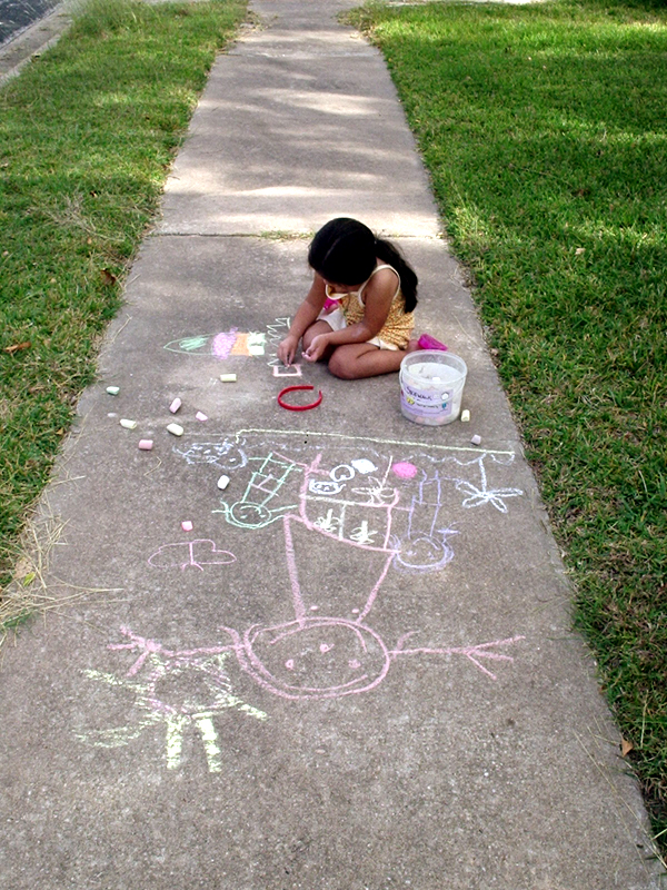 Girl-drawing-on-sidewalk-with-chalk