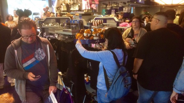 Right after rope drop, fans were grabbing the new Rogue One t-shirts along with an exclusive action figure and Ewok plush.