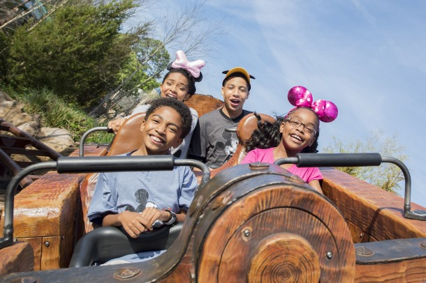"(Clockwise from top left) Actors Yara Shahidi, Marcus Scribner, Marsai Martin and Miles Brown, from the cast of the ABC series ""black-ish,"" ride Seven Dwarfs Mine Train   (Mariah Wild, photographer)"