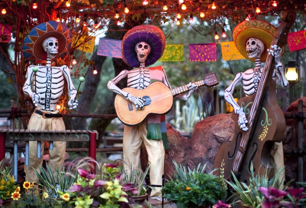 "DIA DE LOS MUERTOS (ANAHEIM, Calif.) – A colorful display at Disneyland park honors Dia de los Muertos with cheerful skeletons, sugar skulls and marigolds during Halloween Time at the Disneyland Resort, from Sept. 9 through Nov.1.  Halloween Time entertains guests with seasonal entertainment and décor, in addition to the return of Haunted Mansion Holiday and Space Mountain Ghost Galaxy. This year, the family-friendly Mickey's Halloween Party will be held on 17 nights at Disneyland park, where guests are invited to trick-or-treat in costume, celebrate with favorite Disney characters and enjoy the ""Halloween Screams"" fireworks spectacular. (Paul Hiffmeyer/Disneyland Resort)"