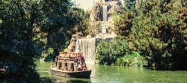 A Mike Fink Keel Boat cruises the Rivers Of America past Cascade Peak