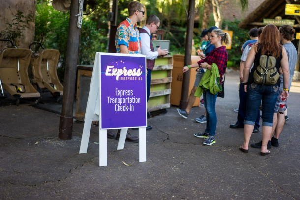 Express transportation loads right near the Safaris entrance, and the loud purple sign doesn't fit in at all.