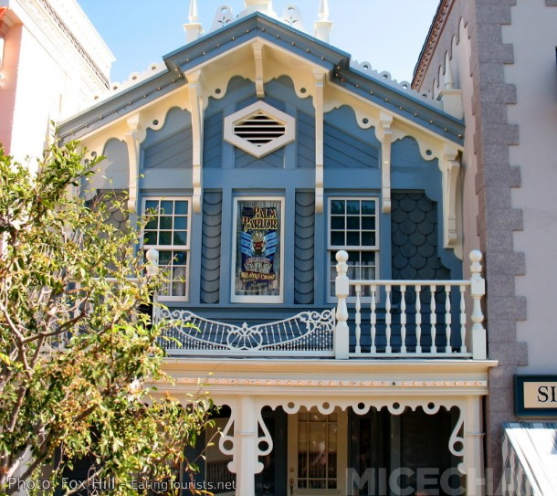 """Rolly's Main Street window holds an honored place above what is now widely known as """"Rolly's Porch."""" The window is full of references to Rolly's important contributions to Disneyland."""